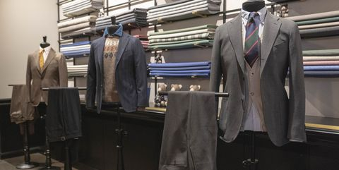 Boutique, Suit, Fashion, Outerwear, Room, Blazer, Outlet store, Jacket, Display window,