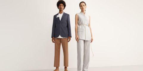 White, Clothing, Suit, Standing, Formal wear, Fashion, Outerwear, Shoulder, Blazer, Pantsuit,