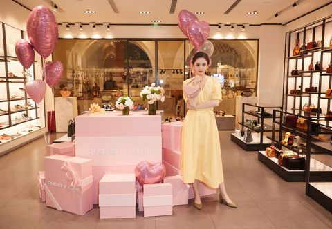 Pink, Boutique, Interior design, Dress, Display window, Building, Retail, Fashion accessory, Peach, Outlet store,