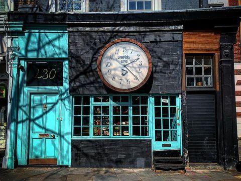 Brickwork, Clock, Turquoise, Wall, Brick, Town, Architecture, Building, Urban area, Facade,
