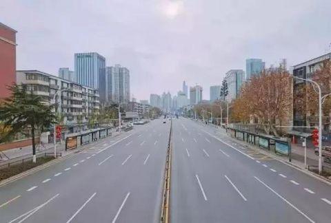 Metropolitan area, Urban area, City, Road, Lane, Daytime, Thoroughfare, Highway, Human settlement, Atmospheric phenomenon,
