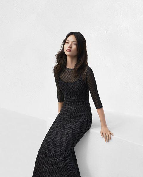 Black, Clothing, Fashion model, Dress, Shoulder, Little black dress, Beauty, Fashion, Photo shoot, Waist,