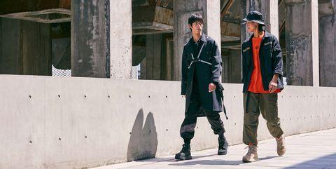 Standing, Street fashion, Uniform, Military uniform, Boot, Cargo pants, Concrete, Column,