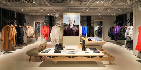 Boutique, Interior design, Building, Fashion, Automotive design, Room, Ceiling, Design, Architecture, Furniture,
