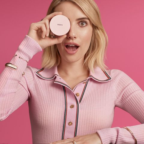 Pink, Skin, Beauty, Blond, Material property, Ear, Sleeve, Outerwear, Photography, Fashion accessory,