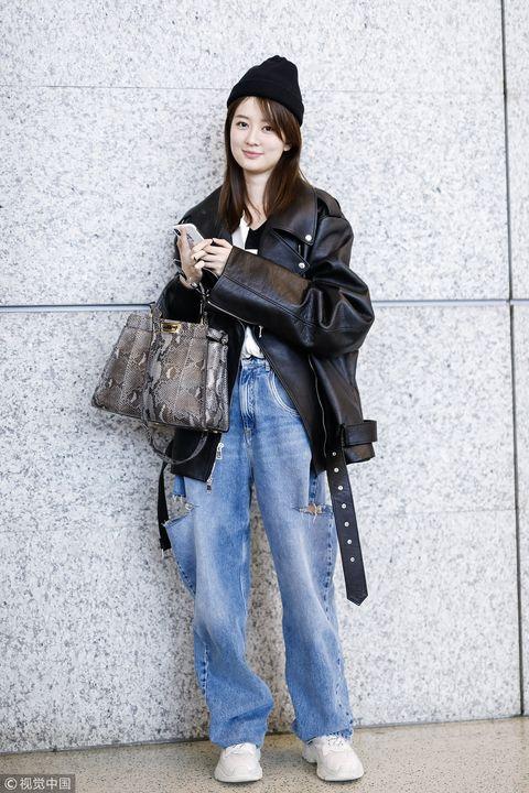 Clothing, Street fashion, Jeans, Fashion, Snapshot, Shoulder, Outerwear, Headgear, Denim, Trousers,