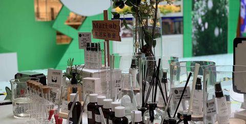 Design, Glass bottle, Material property, Table, Glass, Centrepiece, Restaurant, Interior design,