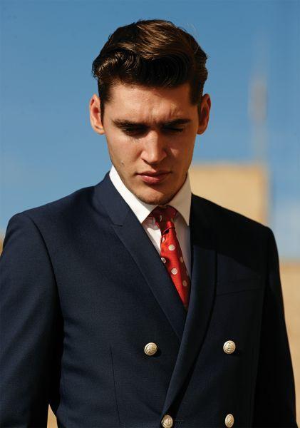 Suit, Hair, Formal wear, Forehead, Tuxedo, White-collar worker, Hairstyle, Chin, Blazer, Outerwear,