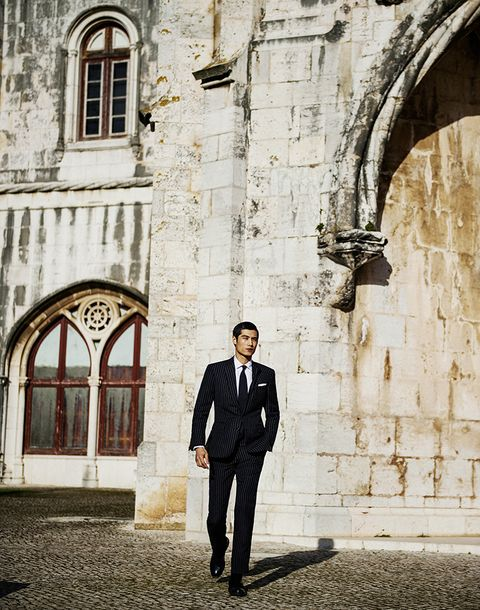 Photograph, Suit, Formal wear, Standing, Tuxedo, Architecture, Photography, Outerwear, Arch, Building,