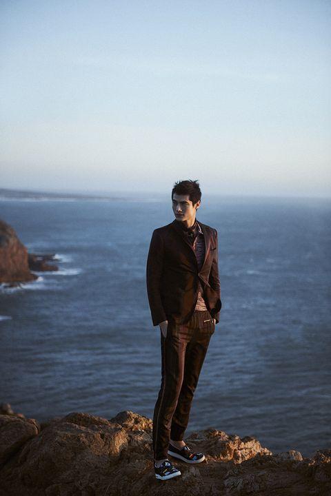 Sky, Sea, Ocean, Standing, Horizon, Coast, Human, Photography, Rock, Outerwear,