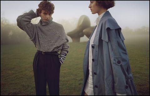 Photograph, Atmospheric phenomenon, Standing, Outerwear, Adaptation, Photography, Romance, Love, Smile, Gesture,