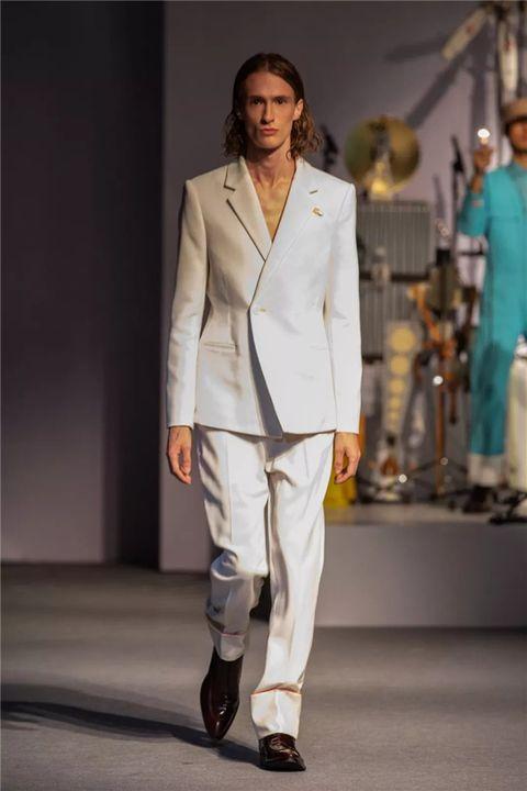 Fashion, Clothing, White, Suit, Fashion model, Fashion show, Runway, Formal wear, Blazer, Outerwear,