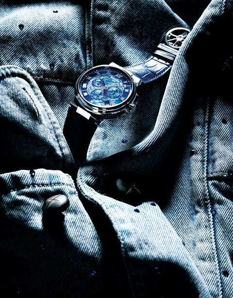 Blue, Watch, Still life photography, Outerwear, Design, Electric blue, Colorfulness, Photography, Pattern, Fashion accessory,