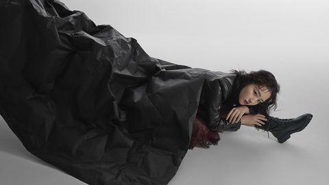 Black, Fashion, Leg, Sitting, Arm, Black hair, Outerwear, Textile, Jacket, Photography,
