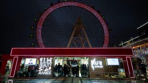 Ferris wheel, Amusement ride, Landmark, Night, Amusement park, Tourist attraction, Wheel, Recreation, Fair, Fun,