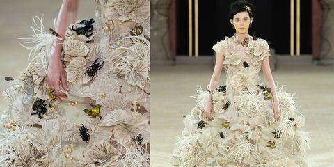 Fashion model, Fashion, Haute couture, Dress, Gown, Clothing, Wedding dress, Bridal clothing, Fashion design, Shoulder,