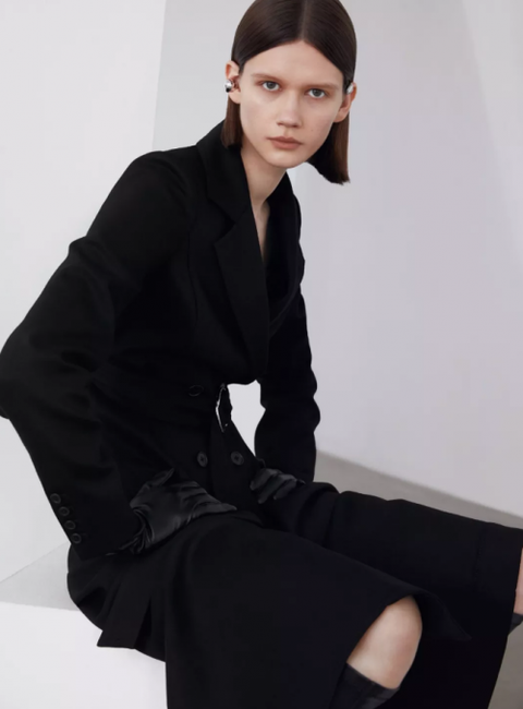 Clothing, Sitting, Fashion, Outerwear, Sakko, Black hair, Model, Neck, Formal wear, Photography,