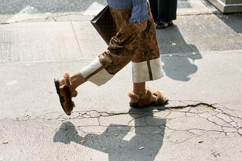 Road surface, Leg, Asphalt, Human leg, Shadow, Sidewalk, Footwear, Cobblestone, Human body, Ankle,