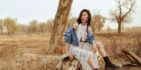 Photograph, Tree, Wood, Grass family, Dress, Photography, Leg, Long hair, Grass, Sitting,