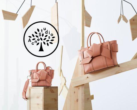 Product, Paper bag, Bag, Handbag, Shopping bag, Packaging and labeling, Tote bag, Fashion accessory, Room, Wood,
