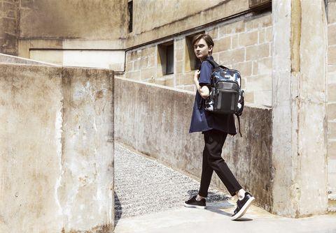 Street fashion, Fashion, Standing, Shoulder, Wall, Footwear, Joint, Leather, Street, Jacket,