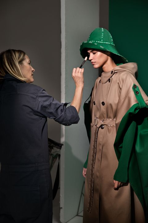 Green, Headgear, Outerwear, Photography, Gesture, Fashion design, Performance, Costume, Coat,