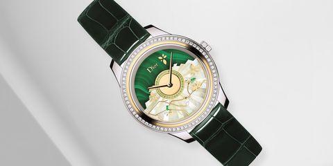 Analog watch, Watch, Watch accessory, Green, Fashion accessory, Jewellery, Strap, Material property, Brand, Hardware accessory,