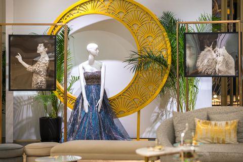 Yellow, Interior design, Room, Architecture, Textile, Art, Window, Plant, Display window, Floral design,