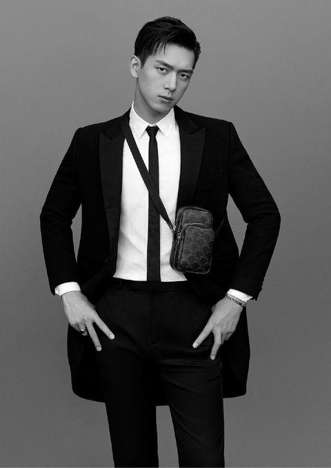 Suit, White, Formal wear, Black, Clothing, Standing, Tuxedo, Outerwear, Blazer, Model,