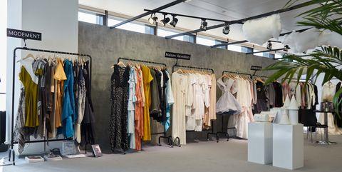 Boutique, Building, Outlet store, Fashion, Ceiling, Interior design, Design, Textile, Floor, Room,