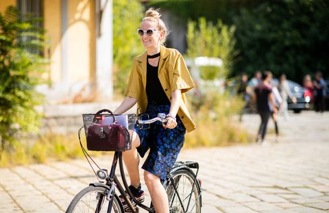 Bicycle, Cycling, Street fashion, Vehicle, Road cycling, Fashion, Bicycle part, Recreation, Shoulder, Beauty,